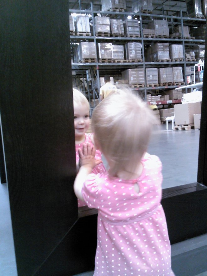 and we let her walk and she found this mirror on display