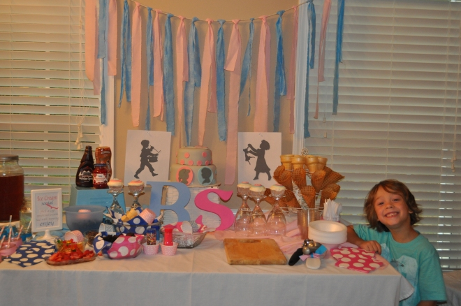 The party table.. I went with the traditional pink and blue for the kids (and i really wanted to use the vintage boy and girl and thought it fit right into the colors!)