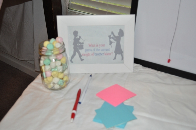 Loved this idea.. the guest were asked to guess how much Baby weighs RIGHT now (at 21 weeks) the jar of mints were also the same weight.. it was great to see all the guesses..-taco guessed 3 inches!:)