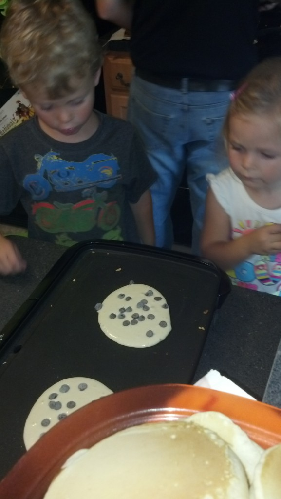 daddy and 3 littles hang out.. making chocolate pancakes